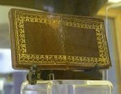 Via Wikipedia. Calling card case made out of Burke's skin.