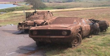 Photo from Newson6.com of 2 cars recovered from the lake