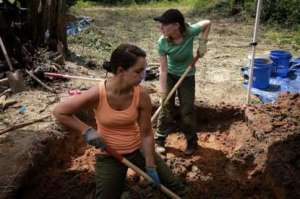 Workers excavation a grave in September.