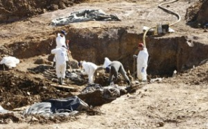 Photo via DailyMail of authorities excavating the mass grave near Prijedor.