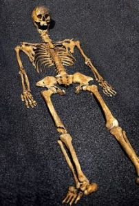 Photo via the DailyMail of a skeleton at Crossbones.  Archaeologists believe she was a prostitute who suffered from rickets and syphilis.