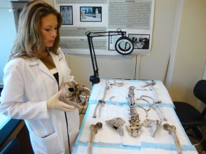 Lori Baker, an associate professor of forensic anthropology at Baylor University in Waco, TX, inventories human remains recovered on a South Texas ranch.