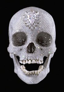 Photo via Wikipedia, ''For the Love of God'', sculpture by Damien Hirst, platinum cast of a human skull covered with 8,601 diamonds. Copyright Damien Hirst.