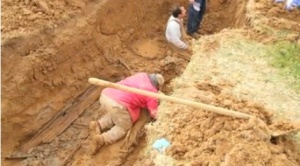 Workers excavating at the Herrin City Cemetery