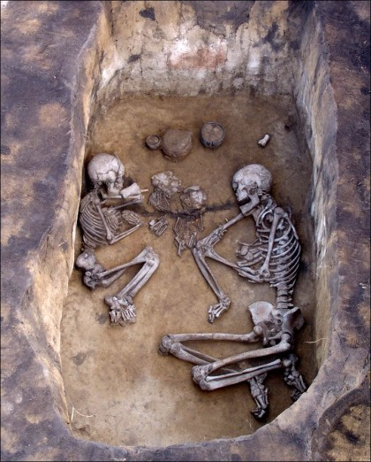 Photo via the Siberian Times of an Andronovo burial containing a couple and children.