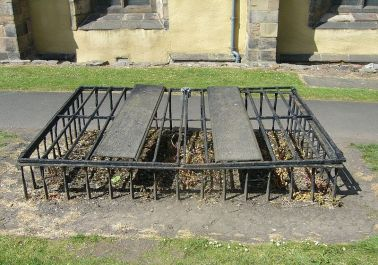 One of two fine specimens of mortsafe in Greyfriars Kirkyard.  Photo from Wikipedia.