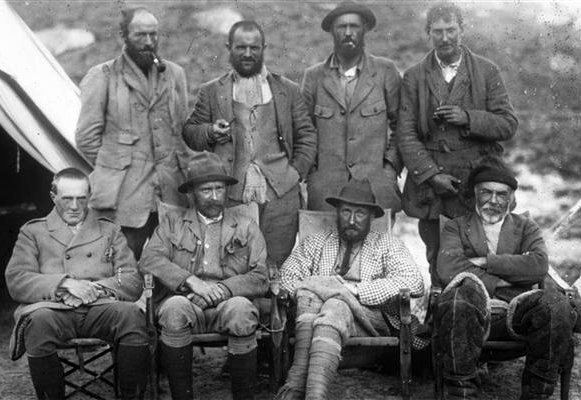 George Mallory pictured during his 1921 Everest Expedition; Mallory right on rear row. Image credit: Fcarcena01 on Wikipedia