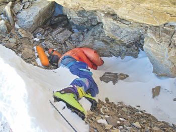 "Body of ""Green Boots"" laying on his side near a cave along the Northeast Route of Mt. Everest"