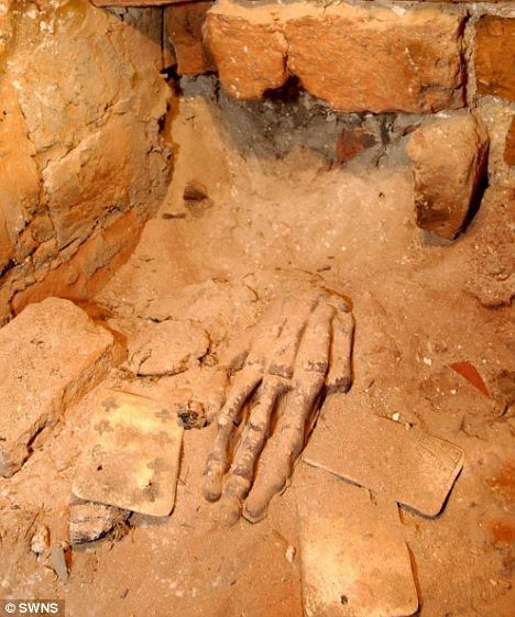 Mummified gambler's hand displayed with an 18th century pack of playing cards.  Image credit: SWNS