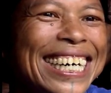 Mantawai woman with chiseled teeth. Image credit: National Geographic from YouTube