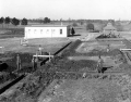 """Dining hall construction with """"White House"""" in background, 1936.  Image Credit: Wikipedia"""