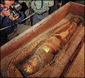 """""""Persian Mummy"""" and sarcophagus being examined by Iranian offices.  Image Credit: The Circle of Ancient Iranian Studies"""
