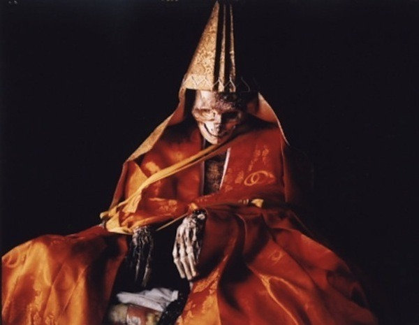 The mummified body of Daijuku Bosatsu Shinnyokai-Shonin of the Dainichi-Boo Temple of Japan. Image Credit: Atlas Obscura
