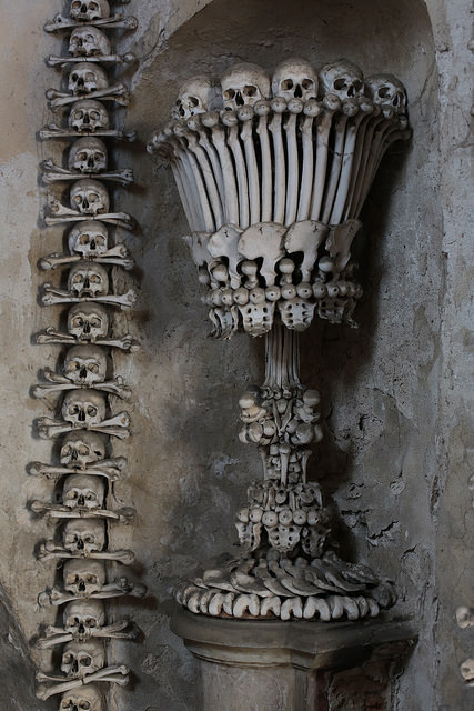 One of the bone chalices on either side of the entrance to the main room at Sedlec. Image Credit: Chris Waits on Flickr.