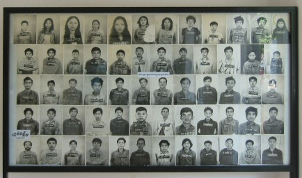 Photographic display of inmates in Tuol Sleng Museum of Genocide.  Image credit: Gary Jones via Wikipedia.