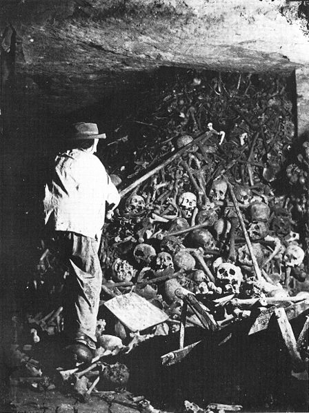 Worker piling bones in the Paris Catacombs, photo ca. 1861.  Image from Wikipedia.