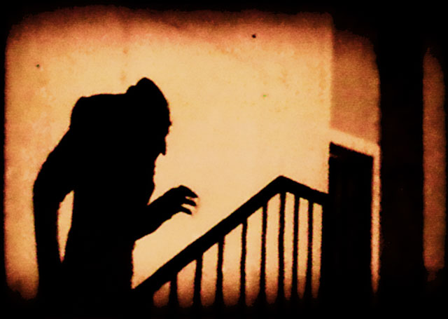 An iconic scene of the shadow of Count Orlok climbing up a staircase.  Image from Wikipedia.
