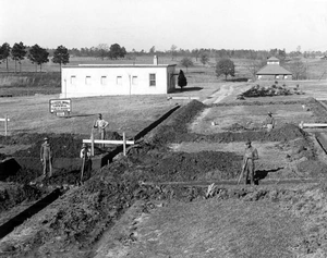 """Dining hall construction with """"White House"""" in background, 1936. Image credit: Mgreason via Wikipedia."""
