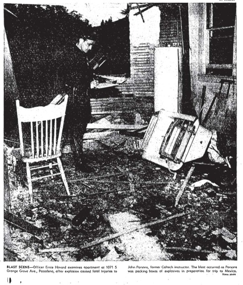 "Pasadena Police Department officer Ernie Howard at the scene of the explosion that killed John Whiteside ""Jack"" Parsons. Image from Wikipedia"
